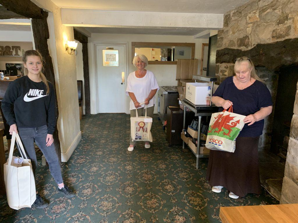Siop volunteers preparing deliveries.
